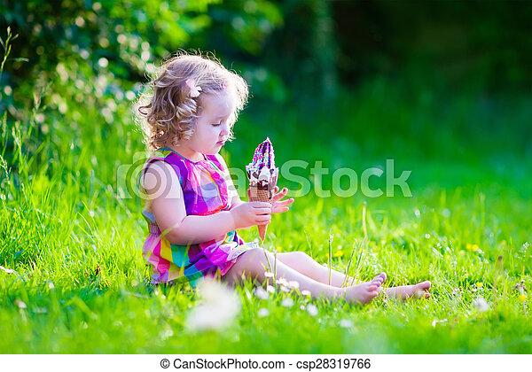 Little girl eating ice cream