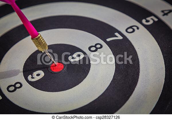 Dartboard on wood wall (Darts Hit Target) - csp28327126