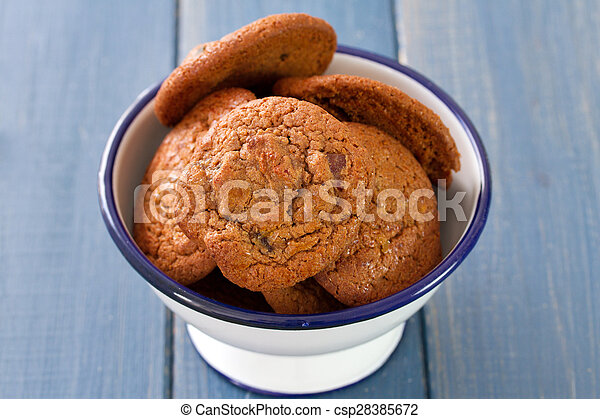 cookies in bowl on blue wooden background
