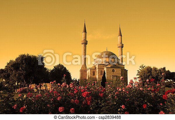 Mosque with two minarets in Baku, Azerbaijan at sunset - csp2839488