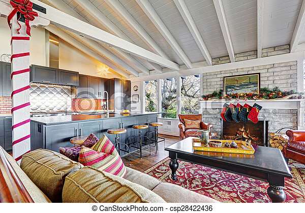 Holiday winter decor living room interior with white vaulted wood ceiling.