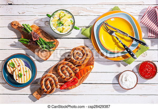 Barbeque Meal Arranged on White Picnic Table
