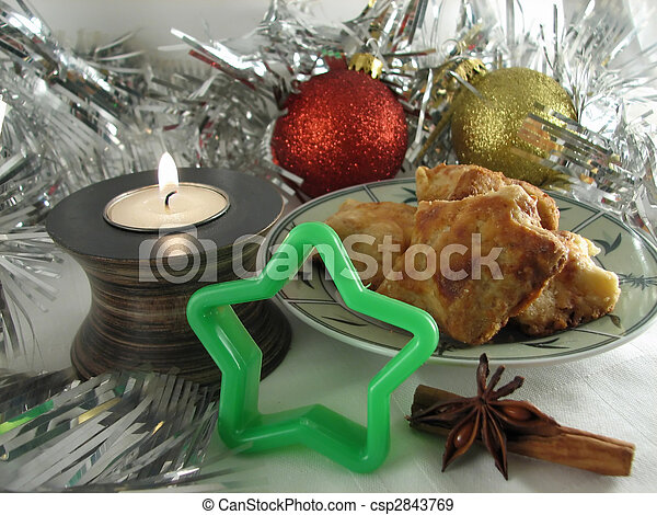Star shaped cookie and candle on a Christmas background