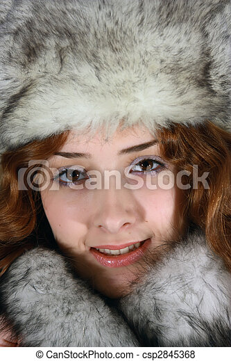 Portrait of girl in arctic fox cap