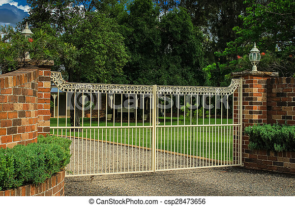 Stock images of metal entrance gates in brick fence for Brick and wrought iron fence designs