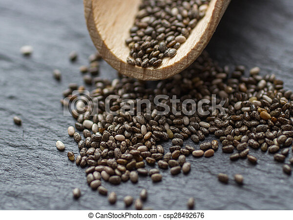 Organic Dry Chia Seeds - a rich source of omega-3 fatty acids. Selective focus
