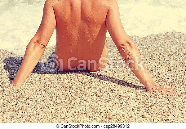 nudist man on the seashore, filtered