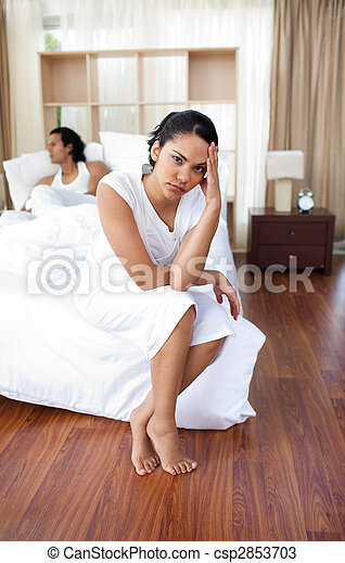 Upset lovers sitting on the bed separately - csp2853703
