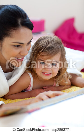 Caring mother reading a book with her girl - csp2853771