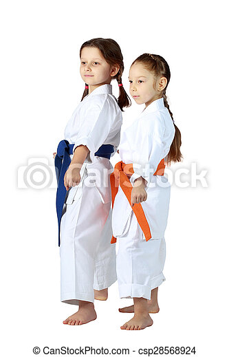 Girls athletes with orange and blue belt stand in rack