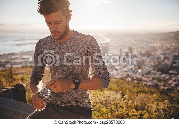 Runner taking break and drinking water