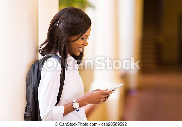 female afro american university student using cell phone