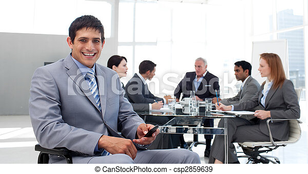 Smiling businessman in a wheelchair sending a text - csp2859639