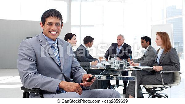 Smiling businessman in a wheelchair sending a text - csp2859639
