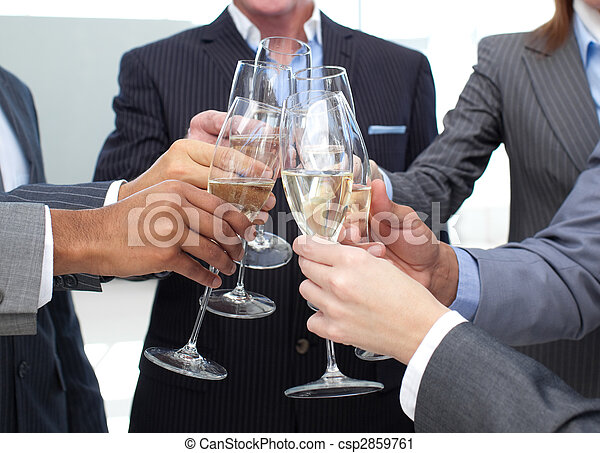 Close-up of business team toasting with Champagne - csp2859761