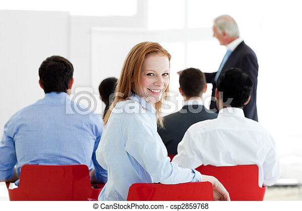 Smiling caucasian businesswoman at a conference - csp2859768