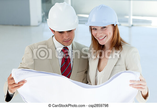 Two architects discussing a construction plan  - csp2859798