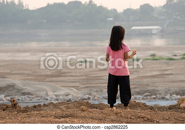 Laotian girl watching Mekong river - csp2862225