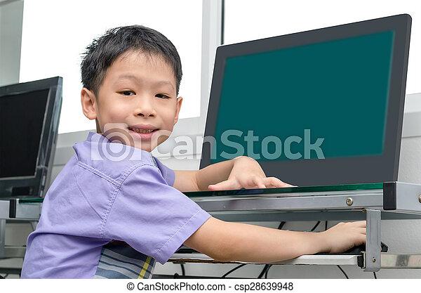 schoolboy using computer