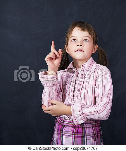 schoolchild on blackboard background