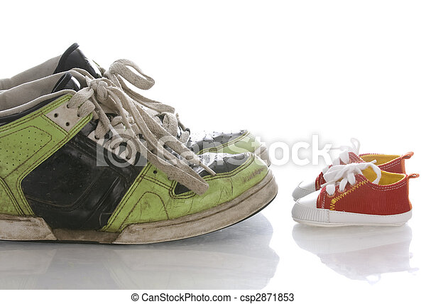 big old shoes and new baby or infant shoes - csp2871853