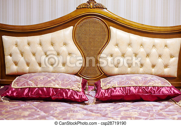 Double bed with decorative headboard
