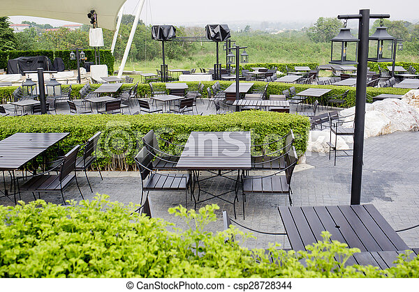 Outdoor restaurant open air chairs with table. Summer