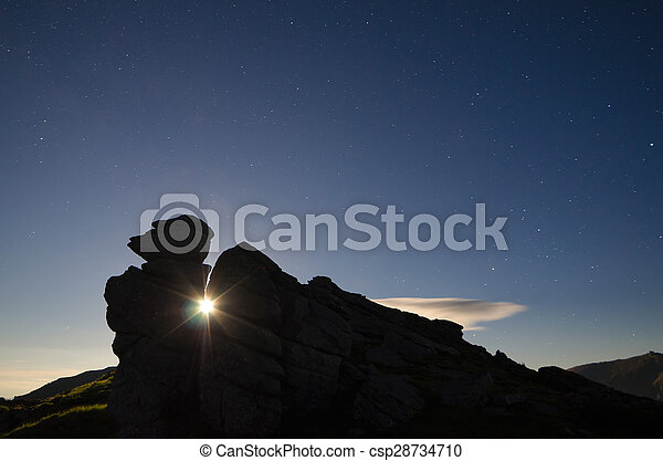 Night landscape with a rock