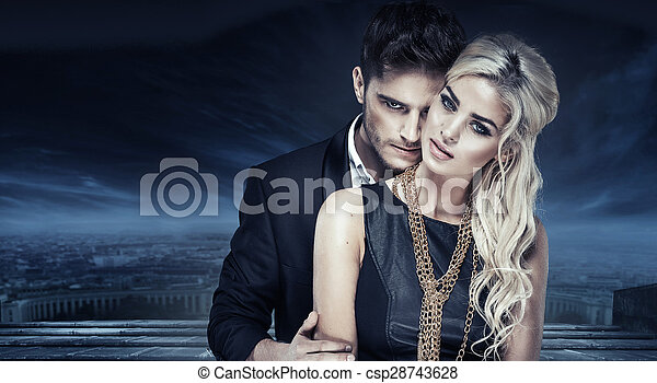Portrait of a young couple over the urban background