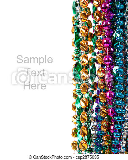 Mardi gras beads on white with copy space - csp2875035