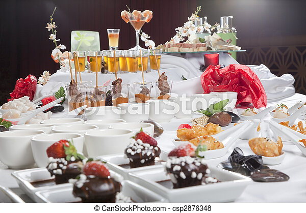 Asian Fusion appetizers and desserts on table - csp2876348
