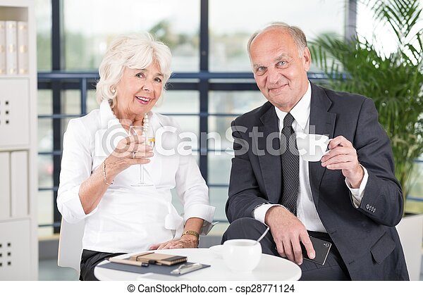 Pair of mature business workers