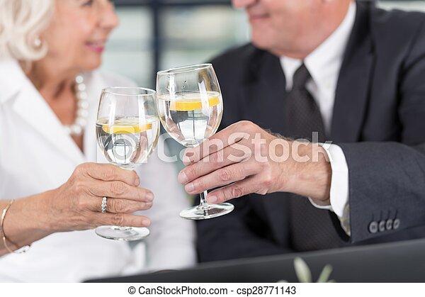 Senior business pair celebrating