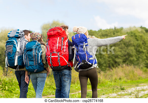 group of friends with backpacks hiking