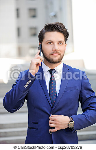 Pleasant man talking on mobile phone
