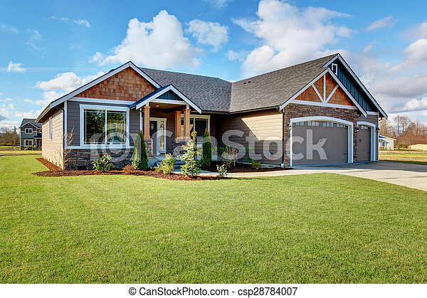 Large modern house with stone and walkway.