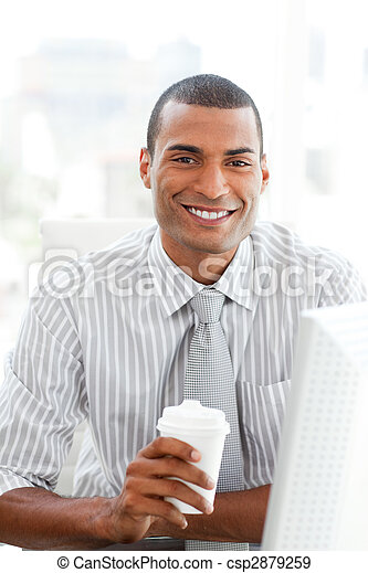 Afro-american businessman drinking a coffee - csp2879259
