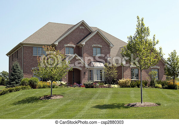 Luxury brick home with arched entry - csp2880303