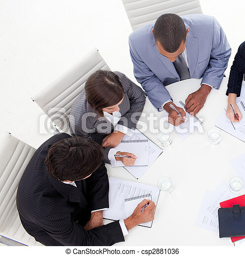 High angle of an international young business people discussing a new strategy in the office - csp2881036