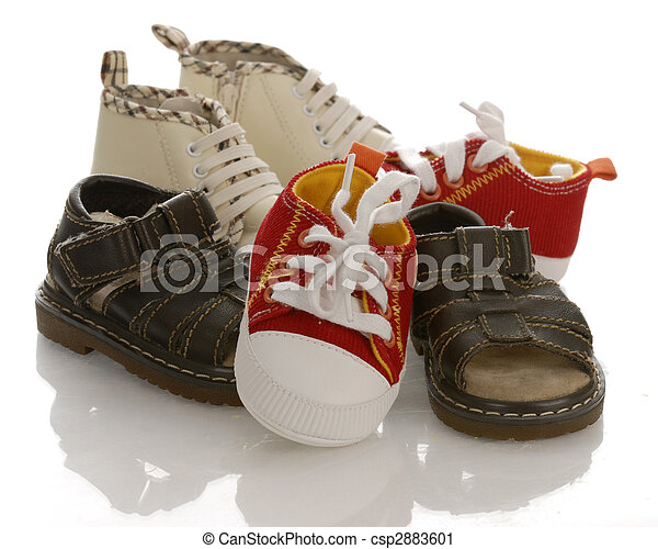 pile of baby or infant shoes with reflection on white background - csp2883601