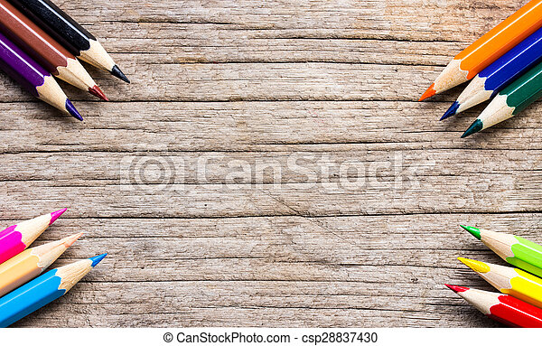 Colorful pencils background on wooden floor