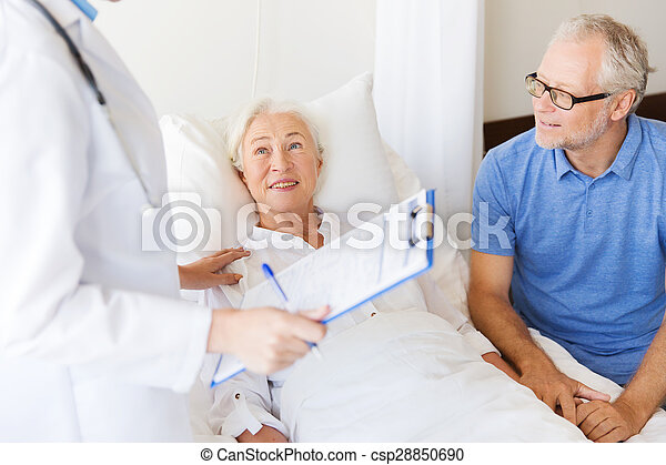 senior woman and doctor with clipboard at hospital
