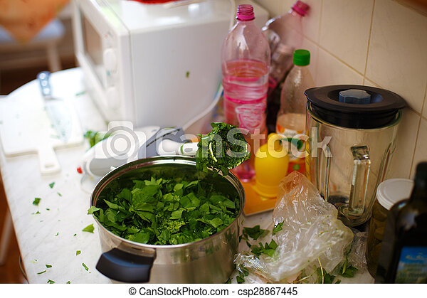 mess in the kitchen. And green salate.