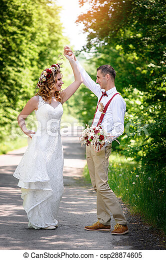 bride and groom walking on the road