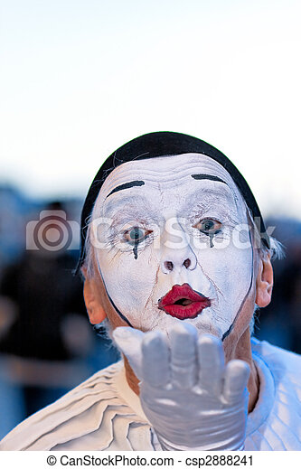 Clown entertain the crowds at a street festival in Venice, Italy - csp2888241