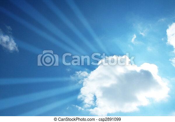 Blue sky and sun beams through the cloud - csp2891099