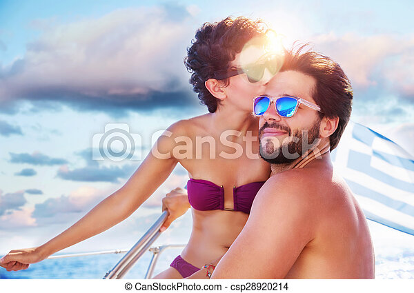 Loving couple on sailboat