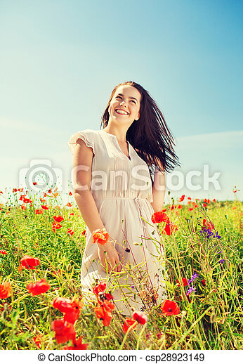 smiling young woman on poppy field
