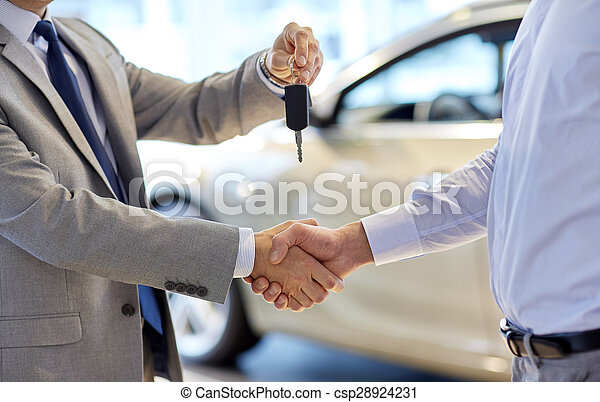 close up of handshake in auto show or salon
