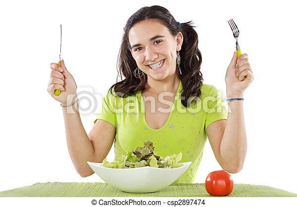 adolescent eating a salad - csp2897474